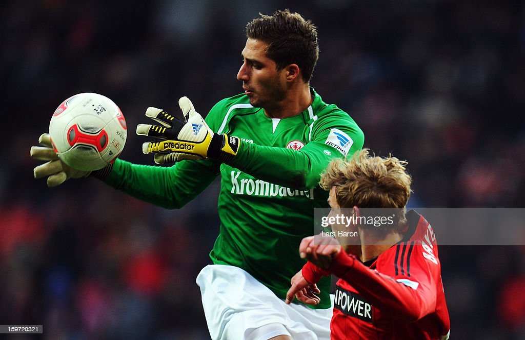 Goalkeeper <a gi-track='captionPersonalityLinkClicked' href=/galleries/search?phrase=Kevin+Trapp&family=editorial&specificpeople=4409868 ng-click='$event.stopPropagation()'>Kevin Trapp</a> of Frankfurt catches the ball next to <a gi-track='captionPersonalityLinkClicked' href=/galleries/search?phrase=Stefan+Kiessling&family=editorial&specificpeople=605405 ng-click='$event.stopPropagation()'>Stefan Kiessling</a> of Leverkusen during the Bundesliga match between Bayer 04 Leverkusen and Eintracht Frankfurt at BayArena on January 19, 2013 in Leverkusen, Germany.
