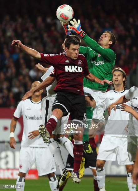 Goalkeeper Kevin Trapp of Frankfurt is challenged by Hanno Balitsch of Nuernberg during the Bundesliga match between 1 FC Nuernberg and Eintracht...