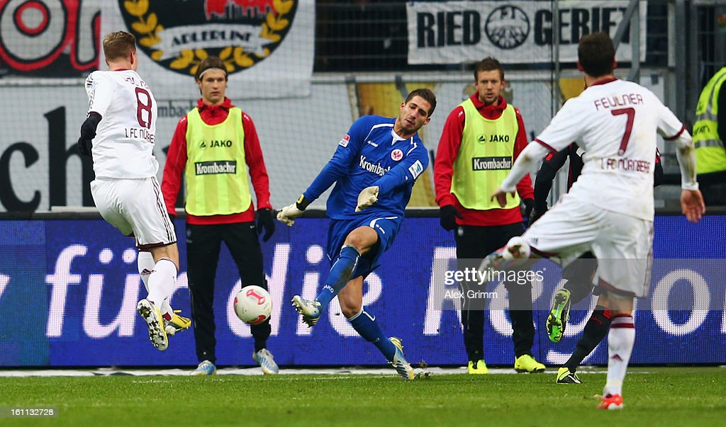 Goalkeeper <a gi-track='captionPersonalityLinkClicked' href=/galleries/search?phrase=Kevin+Trapp&family=editorial&specificpeople=4409868 ng-click='$event.stopPropagation()'>Kevin Trapp</a> of Frankfurt makes a save against Sebastian Polter of Nuernberg during the Bundesliga match between Eintracht Frankfurt and 1. FC Nuernberg at Commerzbank-Arena on February 9, 2013 in Frankfurt am Main, Germany.