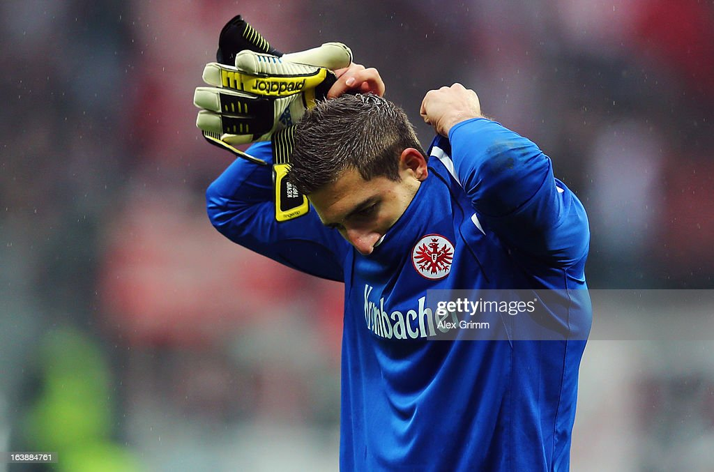 Goalkeeper <a gi-track='captionPersonalityLinkClicked' href=/galleries/search?phrase=Kevin+Trapp&family=editorial&specificpeople=4409868 ng-click='$event.stopPropagation()'>Kevin Trapp</a> of Frankfurt reacts after the Bundesliga match between Eintracht Frankfurt and VfB Stuttgart at Commerzbank-Arena on March 17, 2013 in Frankfurt am Main, Germany.