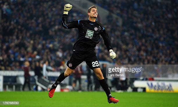 Goalkeeper Kevin Trapp of Kaiserslautern celebrates during the Bundesliga match between FC Schalke 04 and 1 FC Kaiserslautern at Veltins Arena on...