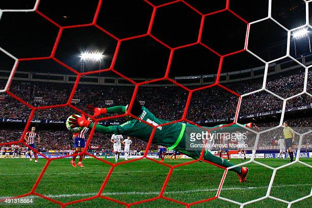 goalkeeper Keylor Navas of Atletico de Madrid stops the penalty shot striked by Antoine Griezmann of Atletico de Madrid during the La Liga match...