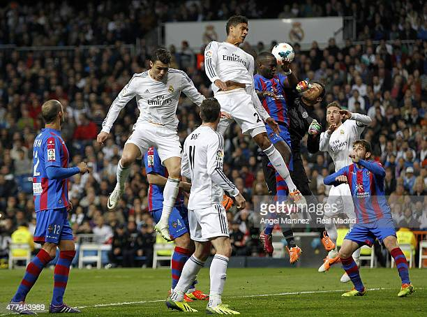 Goalkeeper Keylor Navas of Levante makes a save against Raphael Varane and Cristiano Ronaldo of Real Madrid during the La Liga match between Real...