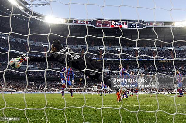 Goalkeeper Keylor Navas of Levante misses to save the opening goal from Cristiano Ronaldo of Real Madrid during the La Liga match between Real Madrid...