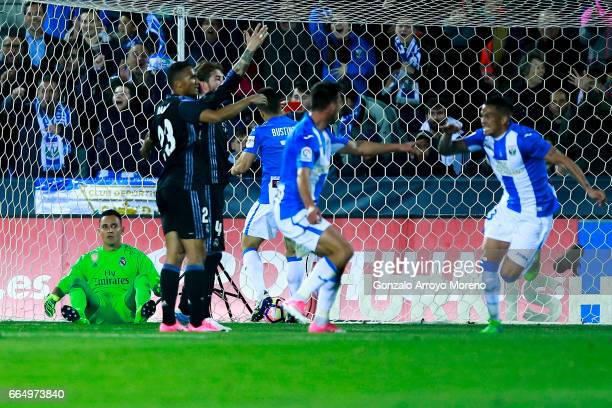 Goalkeeper Keylor Navas of Real Madrid CF reacts as CD Leganes players celebrate their second goal during the La Liga match between CD Leganes and...