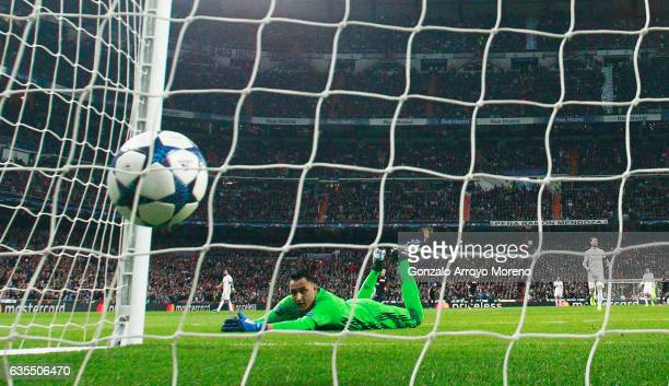 Goalkeeper Keylor Navas of Real Madrid dives in vain as Lorenzo Insigne of Napoli scores their first goal during the UEFA Champions League Round of...