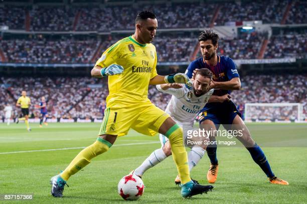 MADRID SPAIN AUGUST 16 Goalkeeper Keylor Navas of Real Madrid in action as Daniel Carvajal Ramos of Real Madrid fights for the ball with Andre Filipe...