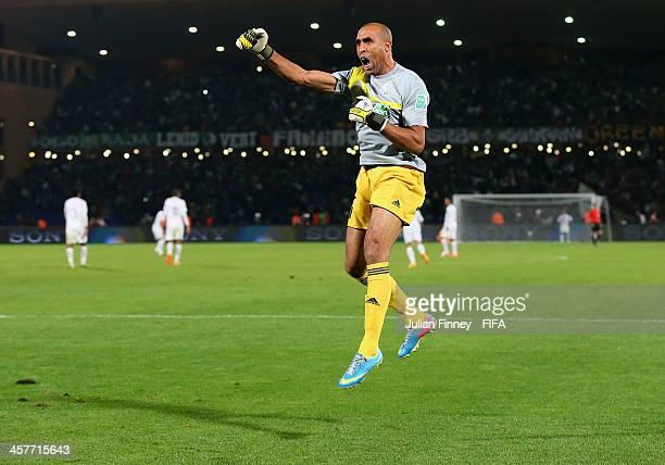 Goalkeeper Khalid Askri of Raja Casablanca celebrates his teams third goal during the FIFA Club World Cup Semi Final match between Raja Casablanca...