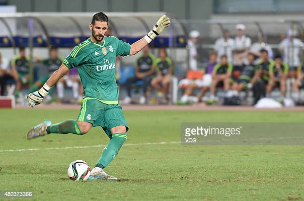 Goalkeeper Kiko Casilla of Real Madrid scores the eleventh penalty kick at the penalty shootout during the International Champions Cup football match...