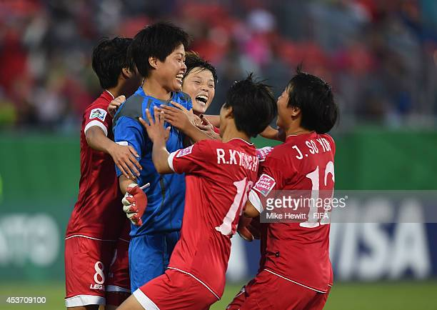 Goalkeeper Kim Chol Ok of Korea DPR is the centre of attention after saving the first 3 penalties of the shoot out during the FIFA U20 Women's World...