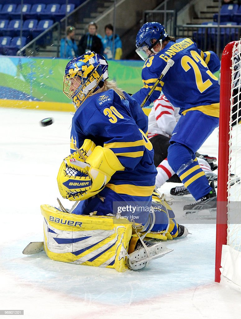 Goalkeeper <a gi-track='captionPersonalityLinkClicked' href=/galleries/search?phrase=Kim+Martin&family=editorial&specificpeople=242970 ng-click='$event.stopPropagation()'>Kim Martin</a> of Sweden has no time to react as the shot from Marie-Philip Poulin of Canada flies past her into the net for goal number two during the ice hockey women's preliminary game between Canada and Sweden on day 6 of the 2010 Winter Olympics at UBC Thunderbird Arena on February 17, 2010 in Vancouver, Canada.