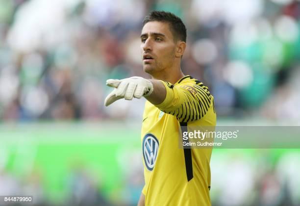 Goalkeeper Koen Casteels of VfL Wolfsburg reacts during the Bundesliga match between VfL Wolfsburg and Hannover 96 at Volkswagen Arena on September 9...