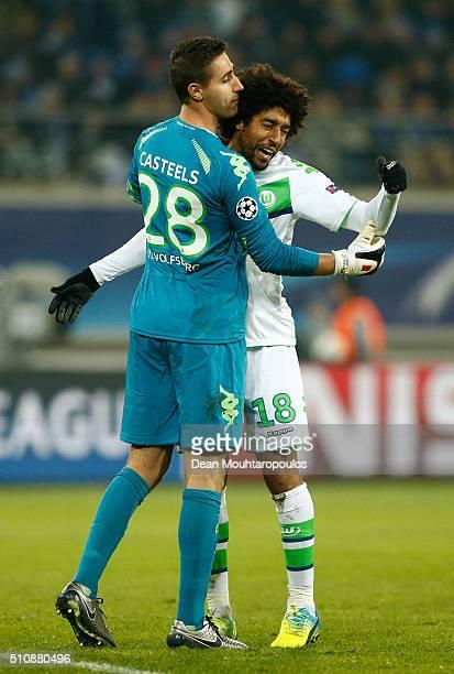Goalkeeper Koen Casteels of Wolfsburg and Dante of Wolfsburg celebrate during the UEFA Champions League round of 16 first leg match between KAA Gent...