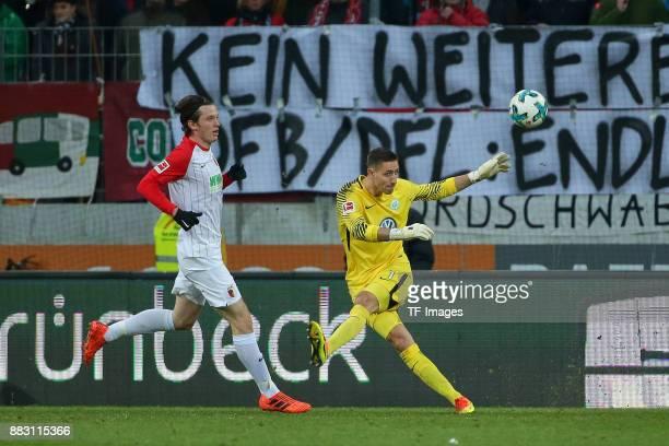 Goalkeeper Koen Casteels of Wolfsburg controls the ball during the Bundesliga match between FC Augsburg and VfL Wolfsburg at WWKArena on November 25...
