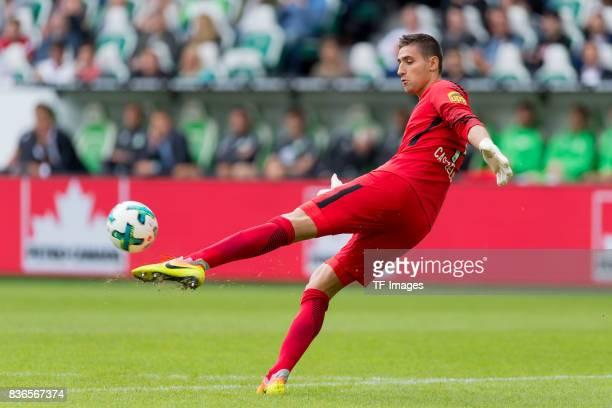Goalkeeper Koen Casteels of Wolfsburg controls the ball during to the Bundesliga match between VfL Wolfsburg and Borussia Dortmund at Volkswagen...