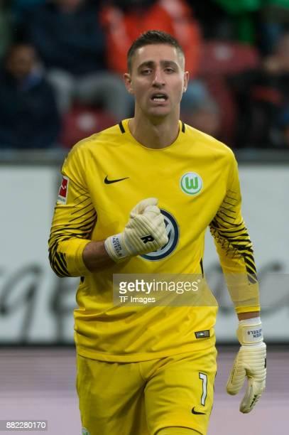 Goalkeeper Koen Casteels of Wolfsburg gestures during the Bundesliga match between FC Augsburg and VfL Wolfsburg at WWKArena on November 25 2017 in...