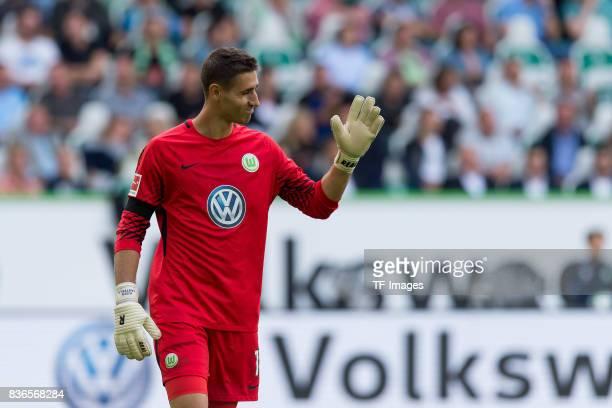 Goalkeeper Koen Casteels of Wolfsburg gestures during to the Bundesliga match between VfL Wolfsburg and Borussia Dortmund at Volkswagen Arena on...