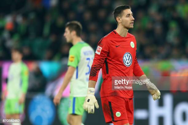 Goalkeeper Koen Casteels of Wolfsburg reacts after Davie Selke of Berlin scored his team's third goal during the Bundesliga match between VfL...