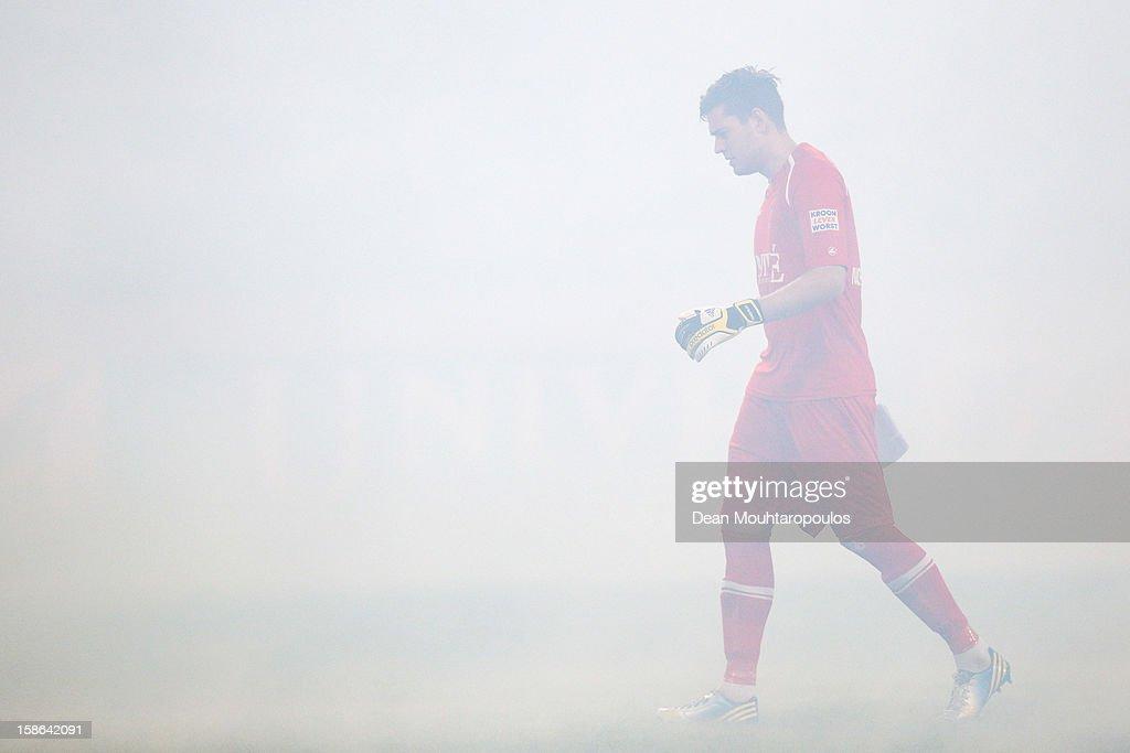 Goalkeeper, Kristoffer Nordfeldt of Heerenveen walks in the smoke from the fireworks prior to the Eredivisie match between SC Heerenveen and Vitesse Arnhem at Abe Lenstra Stadion on December 22, 2012 in Heerenveen, Netherlands.