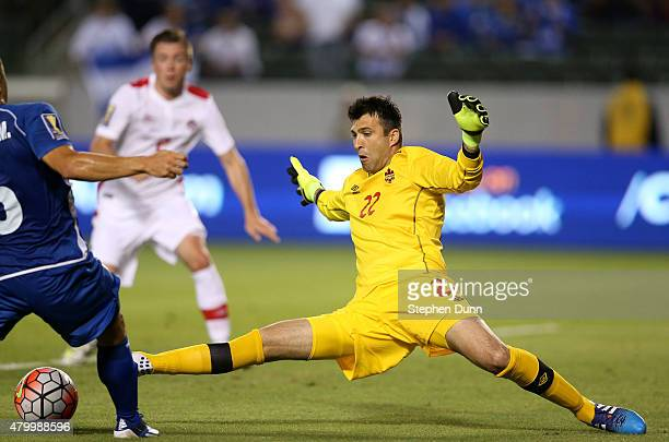 Goalkeeper Kryiakos Stamatopolous of Canada kicks the ball away from Ricahrd Menjivar of El Salvador in their CONCACAF Gold Cup Group B match at...