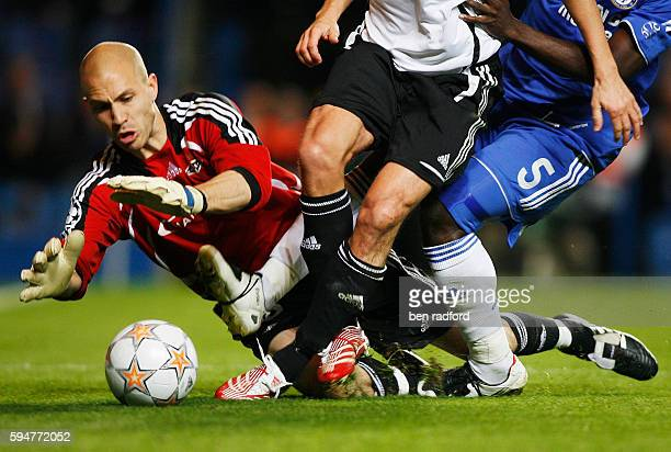 Goalkeeper Lars Hirschfeld of Rosenborg dives in amongst the feet of outfield players to claim the ball during the UEFA Champions League Group B...