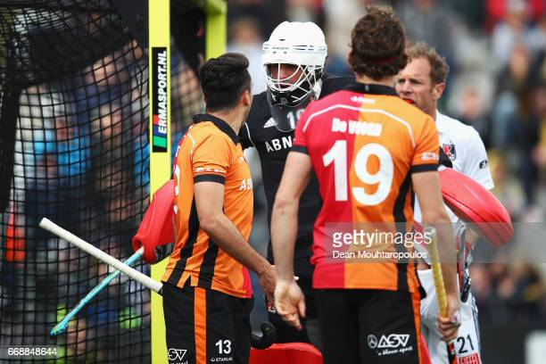 Goalkeeper Laurens Goedegebuure of AH BC Amsterdam confronts Benjamin Stanzl and Bob De Voogd of HC OranjeRood during the Euro Hockey League KO16...
