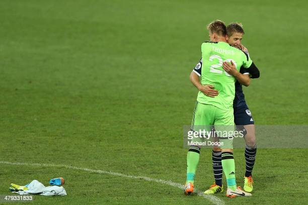 Goalkeeper Lawrence Thomas and Adrian Leijer of the Victory celebrate their victory during the AFC Asian Champions League match between the Melbourne...