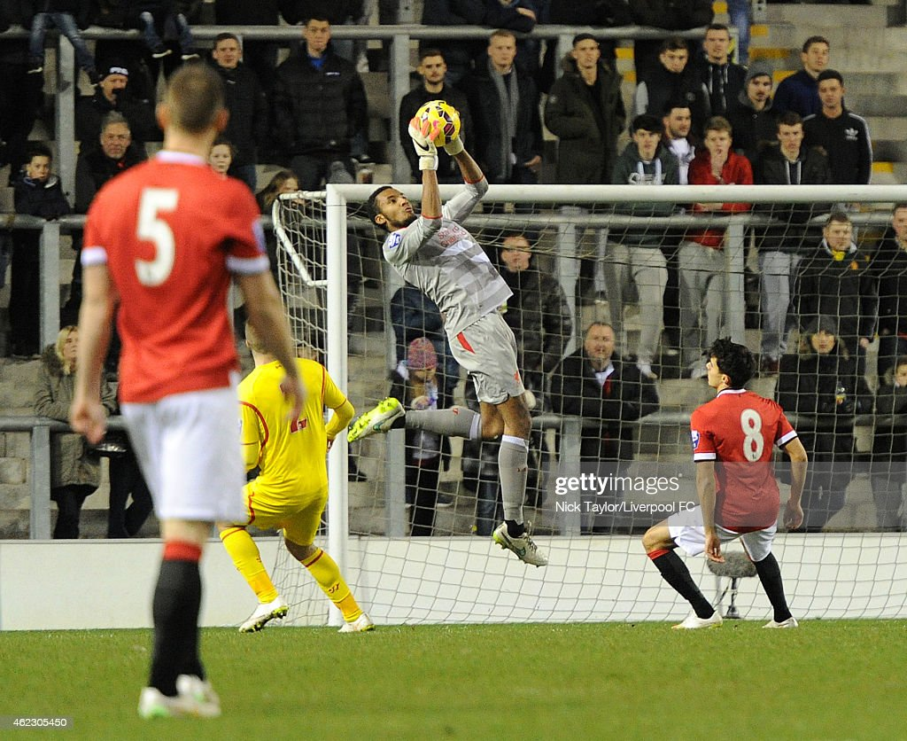 Goalkeeper Lawrence Vigouroux of Liverpool saves a shot from Reece James (8) of Manchester United during the Barclays U21 Premier League match between Manchester United and Liverpool at Leigh Sports Village on January 26, 2015 in Leigh, Greater Manchester.