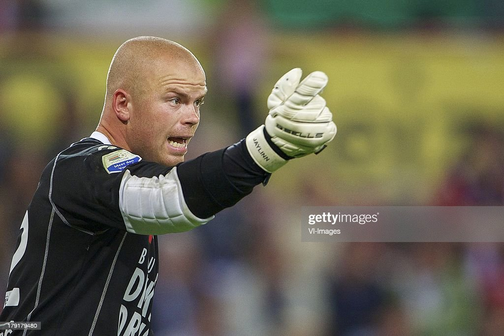 goalkeeper Leonard Nienhuis of SC Cambuur with gloves Sells during the Dutch Eredivisie match between PSV and SC Cambuur at Philips stadium on August 31, 2013 in Eindhoven, The Netherlands.