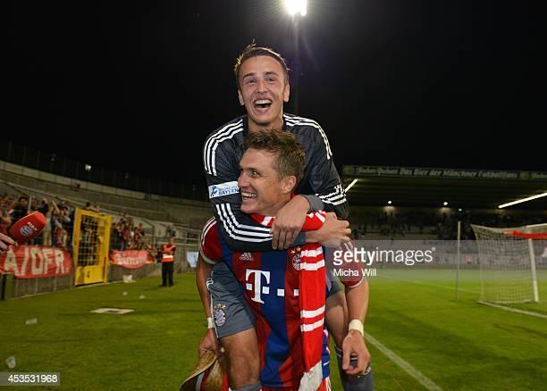 Goalkeeper Leopold Zingerle of Bayern Muenchen jumps on the back of Tobias Schweinsteiger of Bayern Muenchen after the Regionalliga match between TSV...