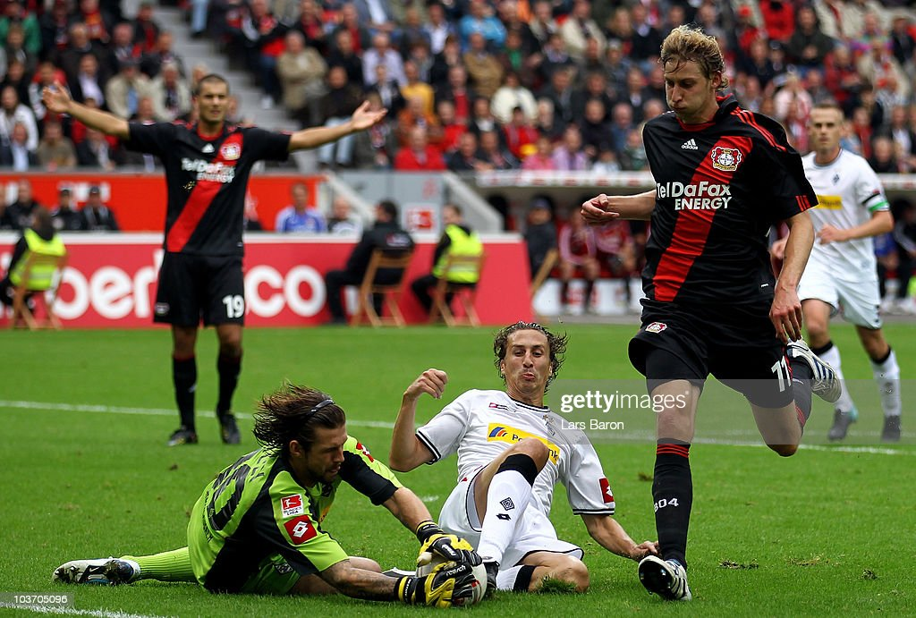 Goalkeeper Logan Bailly of Moenchengladbach catches the ball infront of team mate Roel Brouwers and Stefan Kiessling of Leverkusen between Bayer...