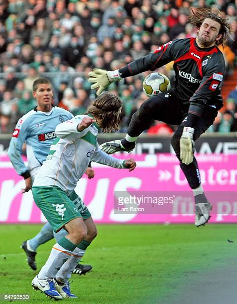 Goalkeeper Logan Bailly of Moenchengladbach saves a header of Torsten Frings of Bremen during the Bundesliga match between Werder Bremen and Borussia...