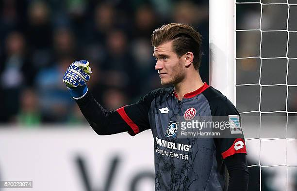 Goalkeeper Loris Karius of Mainz gestures during the Bundesliga match between VfL Wolfsburg and 1 FSV Mainz 05 at Volkswagen Arena on April 9 2016 in...