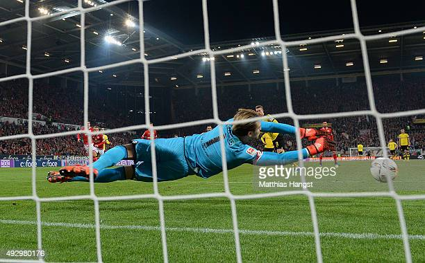 Goalkeeper Loris Karius of Mainz saves a penalty of Marco Reus of Dortmund during the Bundesliga match between 1 FSV Mainz 05 and Borussia Dortmund...