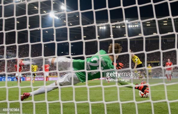 Goalkeeper Loris Karius of Mainz saves a penaltykick of Ciro Immobile of Dortmund during the Bundesliga match between 1 FSV Mainz 05 and Borussia...