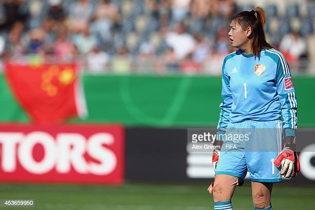Goalkeeper Lu Feifei of China PR reacts during the FIFA U20 Women's World Cup Canada 2014 group B match between the United States and China PR at...