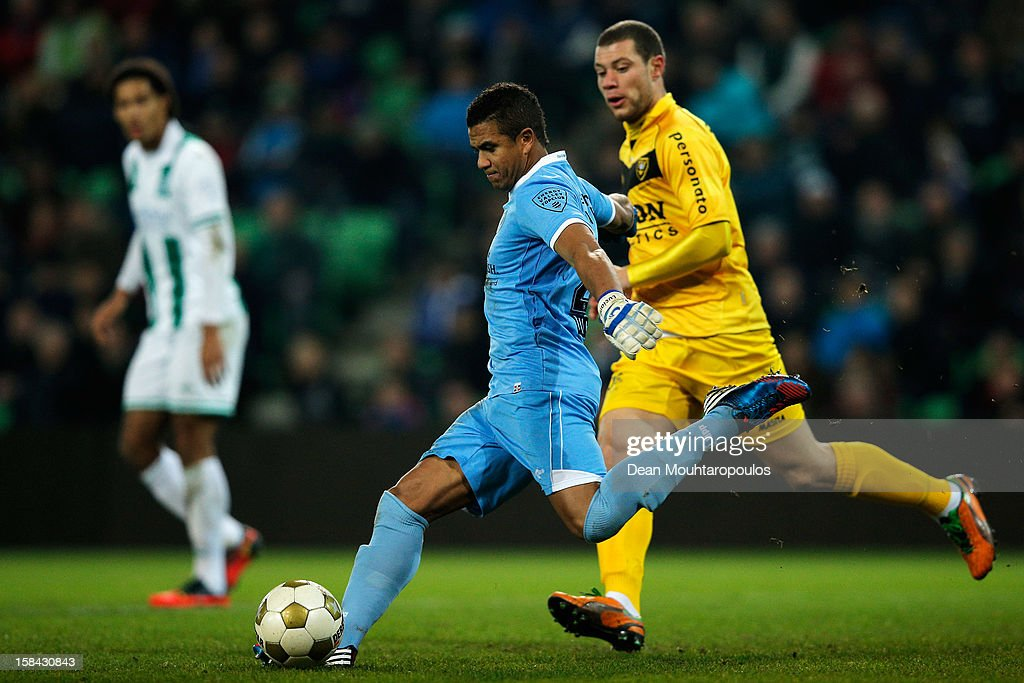 Goalkeeper, Luciano (#26) of Groningen clears the ball away from the attacking Yanic Wildschut of Venlo during the Eredivisie match between FC Groningen and VVV Venlo at the Euroborg Stadium on December 15, 2012 in Groningen, Netherlands.