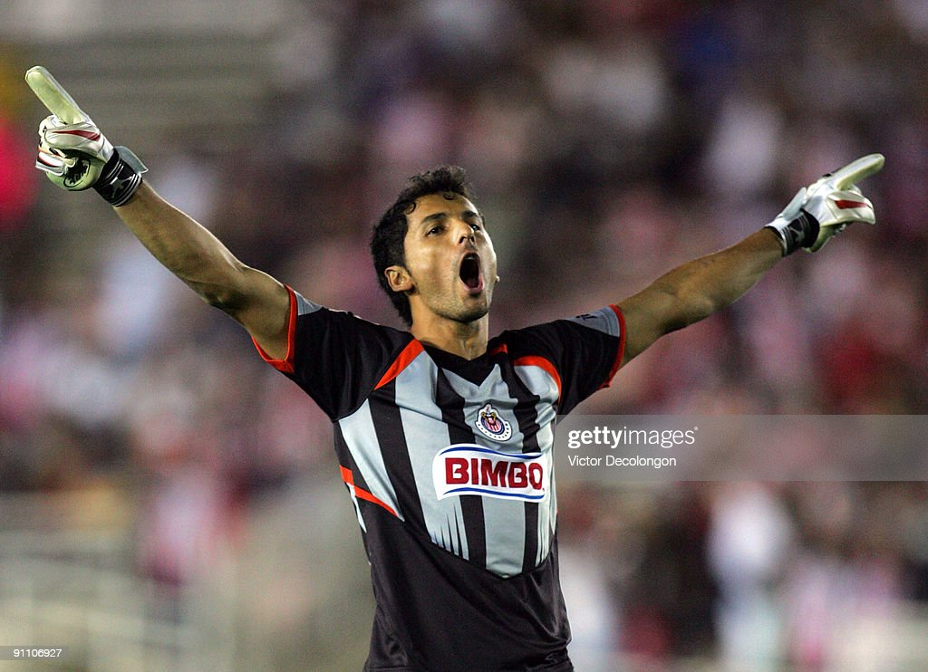 Goalkeeper Luis Michel of Chivas de Guadalajara celebrates the second goal of teammate Omar Arellano in the second half during the International Club...