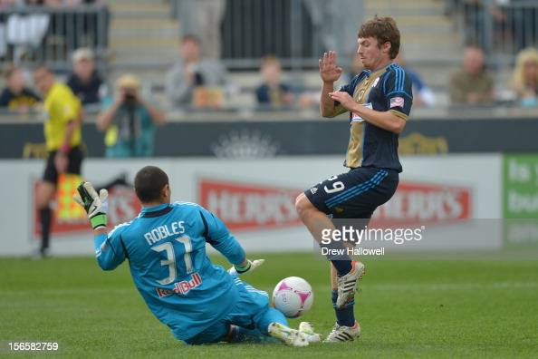 Goalkeeper Luis Robles of the New York Red Bulls makes a save on Antoine Hoppenot of the Philadelphia Union at PPL Park on October 27 2012 in Chester...