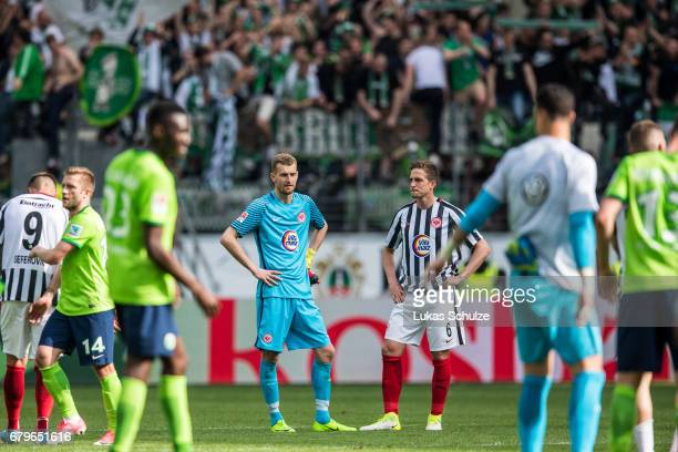 Goalkeeper Lukas Hradecky and Bastian Oczipka of Frankfurt react after loosing the Bundesliga match between Eintracht Frankfurt and VfL Wolfsburg at...