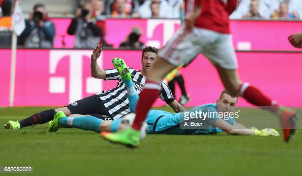 Goalkeeper Lukas Hradecky and David Abraham of Eintracht Frankfurt react as Robert Lewandowski of FC Bayern Muenchen scores a goal during the...