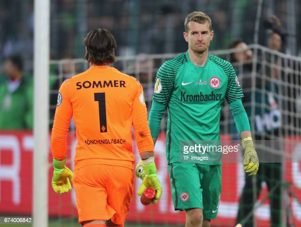 Goalkeeper Lukas Hradecky of Frankfurt and Goalkeeper Yann Sommer of Moenchengladbach looks on during the DFB Cup semi final match between Borussia...