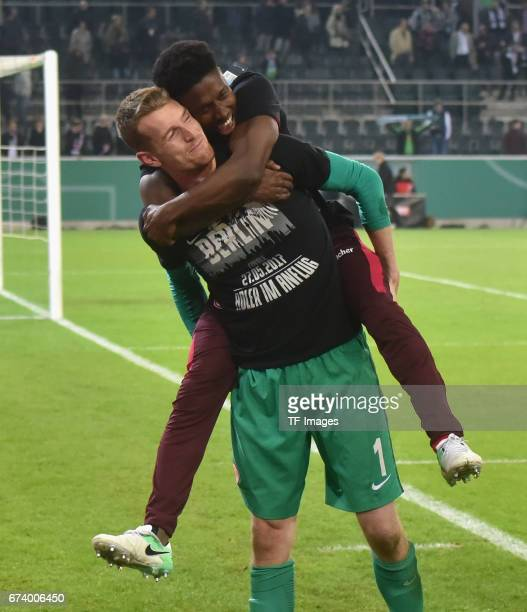 Goalkeeper Lukas Hradecky of Frankfurt and Taleb Tawatha of Frankfurt elebrates with a team after the DFB Cup semi final match between Borussia...