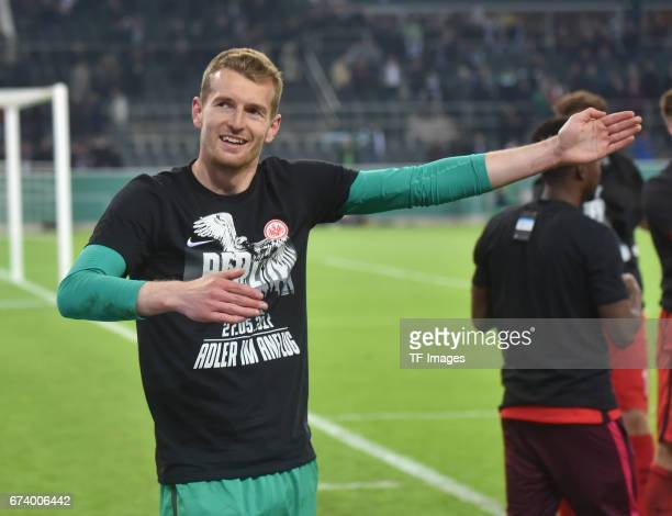 Goalkeeper Lukas Hradecky of Frankfurt elebrates with a team after the DFB Cup semi final match between Borussia Moenchengladbach and Eintracht...