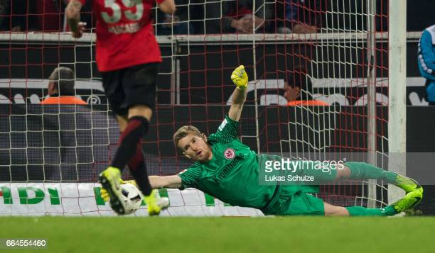 Goalkeeper Lukas Hradecky of Frankfurt gets the first goal of Koeln during the Bundesliga match between 1 FC Koeln and Eintracht Frankfurt at...