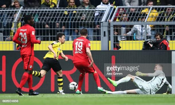 Goalkeeper Lukas Hradecky of Frankfurt makes a save against Shinji Kagawa of Dortmund during the Bundesliga match between Borussia Dortmund and...