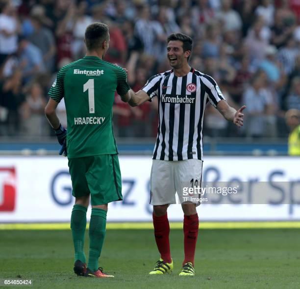 Goalkeeper Lukas Hradecky of Frankfurt und David Abraham of Frankfurt celebrate their win after the Bundesliga match between Eintracht Frankfurt and...