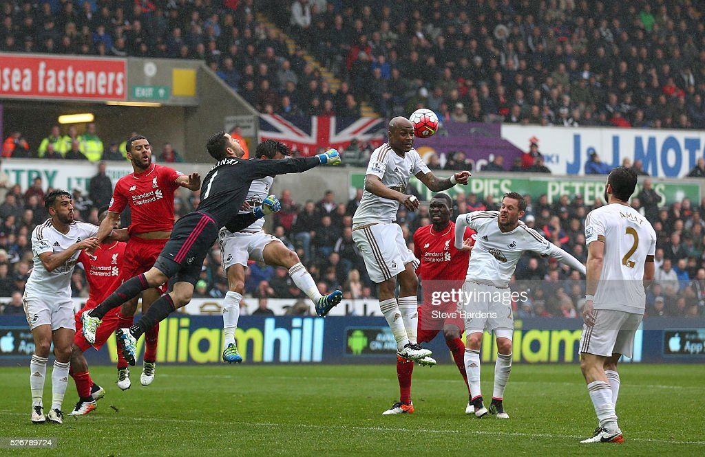 Goalkeeper <a gi-track='captionPersonalityLinkClicked' href=/galleries/search?phrase=Lukasz+Fabianski&family=editorial&specificpeople=560874 ng-click='$event.stopPropagation()'>Lukasz Fabianski</a> of Swansea City punches the ball clear during the Barclays Premier League match between Swansea City and Liverpool at The Liberty Stadium on May 1, 2016 in Swansea, Wales.