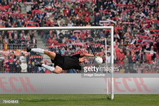 Goalkeeper making a save : Stock Photo