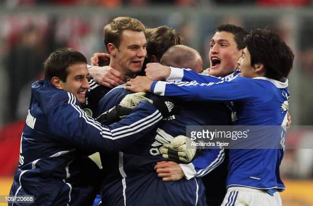 Goalkeeper Manuel Neuer Atsuto Uchida and teammates of Schalke celebrate their team's victory of the DFB Cup semi final match between FC Bayern...